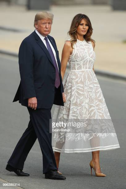 S President Donald Trump and US First Lady Melania Trump attend the evening reception and dinner at the 2018 NATO Summit on July 11 2018 in Brussels...