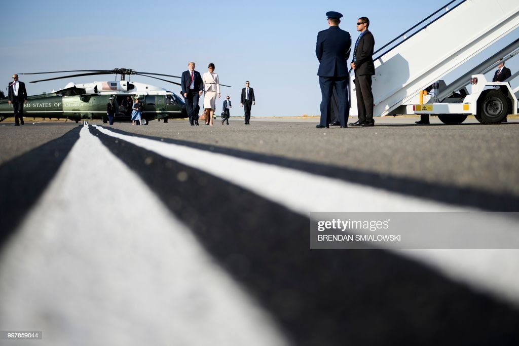US President Donald Trump and US first lady Melania Trump board Air Force One at London Stansted Airport in Stansted on July 13, 2018, the second day of Trump's UK visit. - Queen Elizabeth II welcomed US President Donald Trump for tea at Windsor Castle on Friday -- a meeting which many Britons find the toughest part of his already contentious trip to swallow.