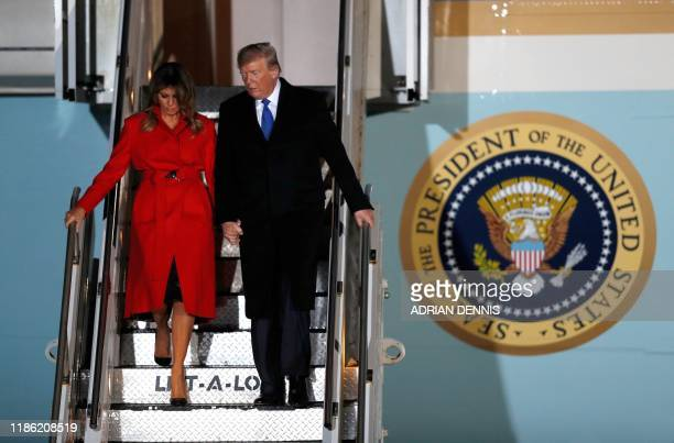 US President Donald Trump and US First Lady Melania Trump disembark Air Force One after landing at Stansted Airport northeast of London on December 2...