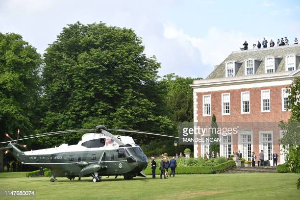 US President Donald Trump and US First Lady Melania Trump disembark Marine One at Winfield House the residence of the US Ambassador in London on June...