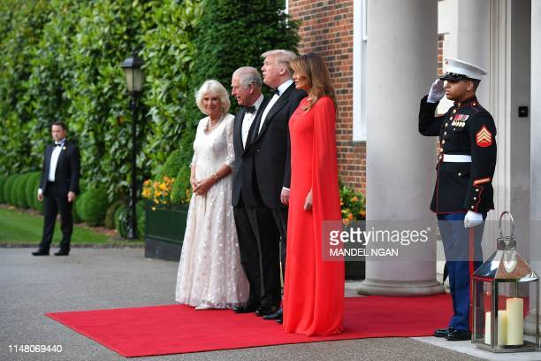 US President Donald Trump and US First Lady Melania Trump greet Britain's Prince Charles Prince of Wales his wife Britain's Camilla Duchess of...