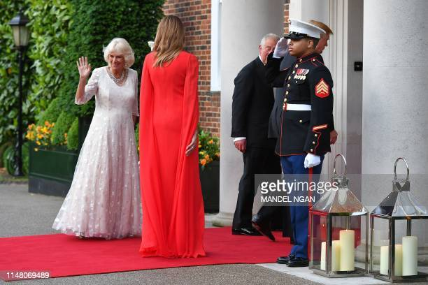 US President Donald Trump and US First Lady Melania Trump greet Britain's Prince Charles Prince of Wales and his wife Britain's Camilla Duchess of...