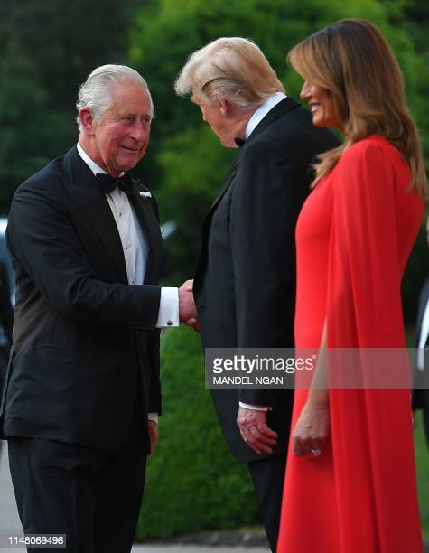 US President Donald Trump and US First Lady Melania Trump greet Britain's Prince Charles Prince of Wales ahead of a dinner at Winfield House the...