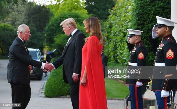 US President Donald Trump and US First Lady Melania Trump greet Britain's Prince Charles Prince of Wales ahead of a dinner Winfield House the...