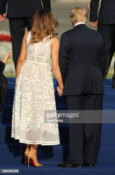 S President Donald Trump and US First Lady Melania Trump join heads of state and governments as well as their spouses gathering for a group photo at...