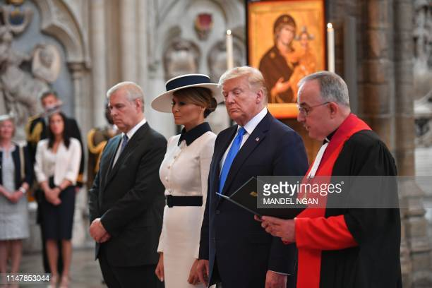 US President Donald Trump and US First Lady Melania Trump lay a wreath on the tomb of the Unknown Warrior accompanied by Britain's Prince Andrew Duke...