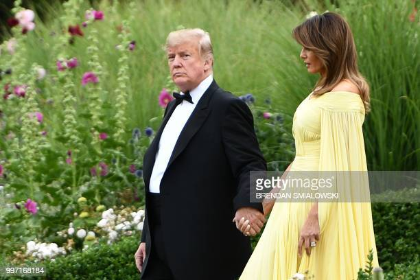 US President Donald Trump and US First Lady Melania Trump leave the US ambassador's residence Winfield House in London on July 12 heading to Blenheim...