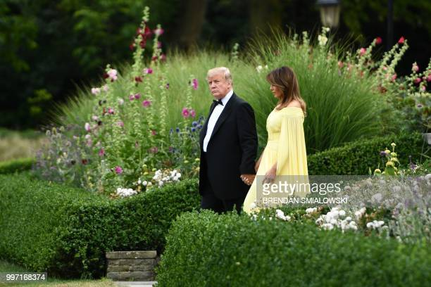 President Donald Trump and US First Lady Melania Trump leave the US ambassador's residence Winfield House in London on July 12 heading to Blenheim...