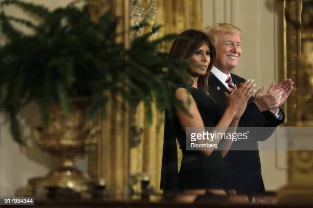 US President Donald Trump and US First Lady Melania Trump left applaud during a National African American History Month reception in Washington DC US...