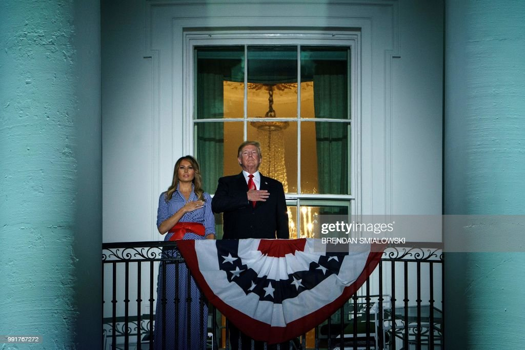 US President Donald Trump and US first lady Melania Trump listen to the US national anthem during a Independence Day celebration on the South Lawn of the White House July 4, 2018 in Washington, DC.