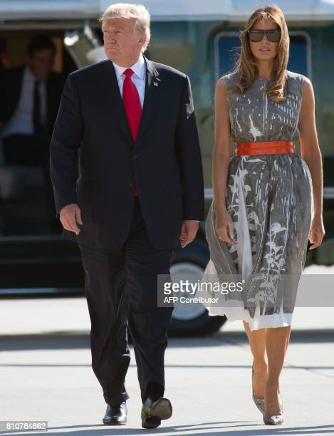 President Donald Trump and US First Lady Melania Trump make their way to board Airforce One after the G20 Summit in Hamburg, Germany, July 8, 2017....