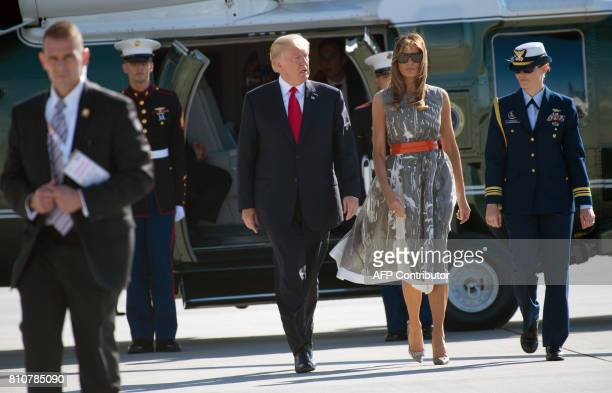President Donald Trump and US First Lady Melania Trump make their way from Marine One to board Airforce One after the G20 Summit in Hamburg Germany...