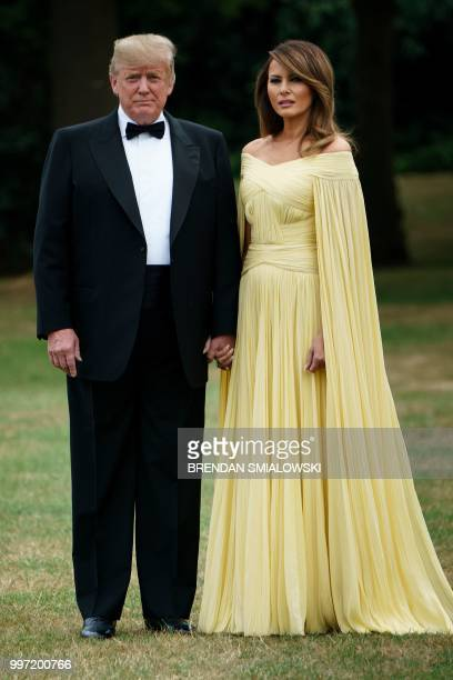 President Donald Trump and US First Lady Melania Trump pose for a picture as they leave the US ambassador's residence, Winfield House, in London on...