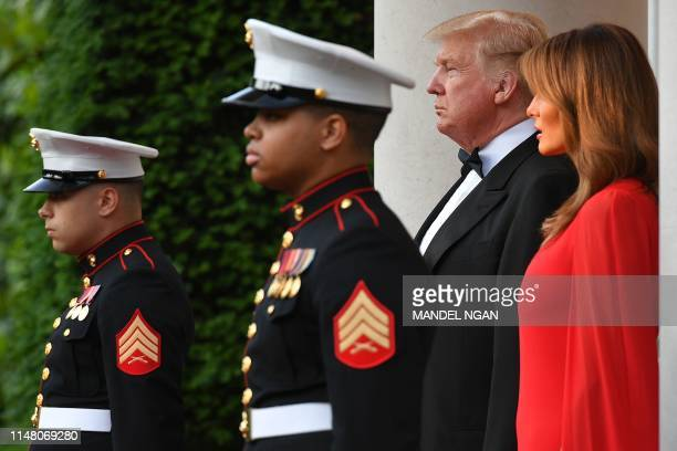 US President Donald Trump and US First Lady Melania Trump prepare to greet Britain's Prince Charles Prince of Wales and his wife Britain's Camilla...