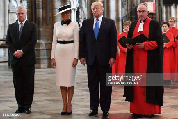 US President Donald Trump and US First Lady Melania Trump stand with Britain's Prince Andrew Duke of York and the Dean of Westmisnter John Hall as...