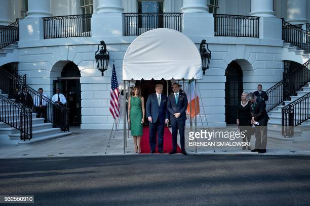 President Donald Trump and US first lady Melania Trump stand with Ireland's Prime Minister Leo Varadkar outside the White House March 15, 2018 in...