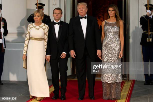 President Donald Trump and US first lady Melania Trump stand with French President Emmanuel Macron and French first lady Brigitte Macron after their...