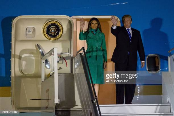US President Donald Trump and US First Lady Melania Trump step off Air Force One upon their arrival at Chopin Airport in Warsawon July 5 2017 Donald...