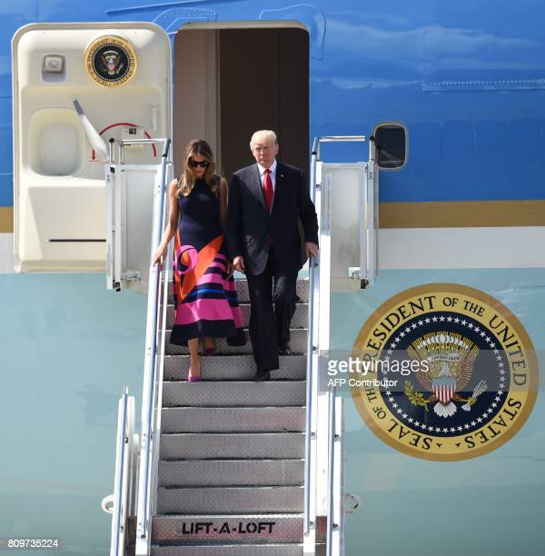US President Donald Trump and US First Lady Melania Trump step off Air Force One upon arrival at the airport in Hamburg northern Germany on July 6...