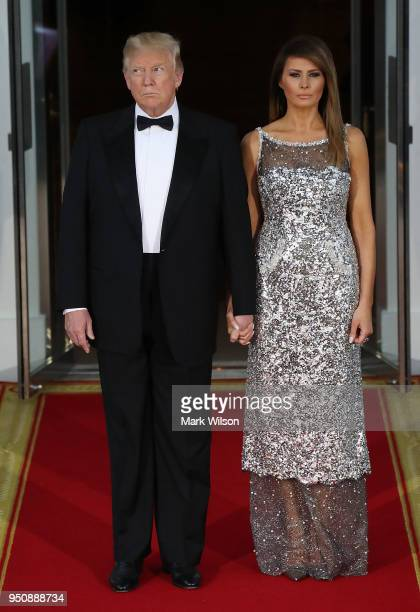 President Donald Trump and US first lady Melania Trump wait for the arrival of French President Emmanuel Macron French first lady Brigitte Macron at...
