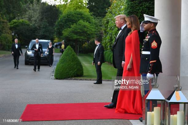 US President Donald Trump and US First Lady Melania Trump wait to greet Britain's Prince Charles Prince of Wales and Britain's Camilla Duchess of...