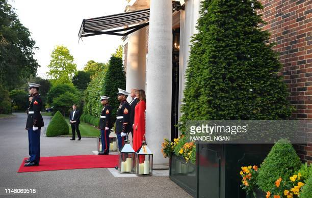 US President Donald Trump and US First Lady Melania Trump wait to greet Britain's Prince Charles Prince of Wales and his wife Britain's Camilla...