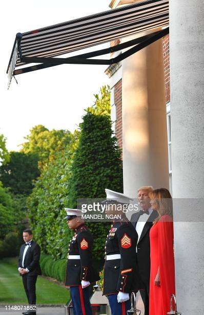 US President Donald Trump and US First Lady Melania Trump wait to greet Britain's Prince Charles Prince of Wales his wife Britain's Camilla Duchess...
