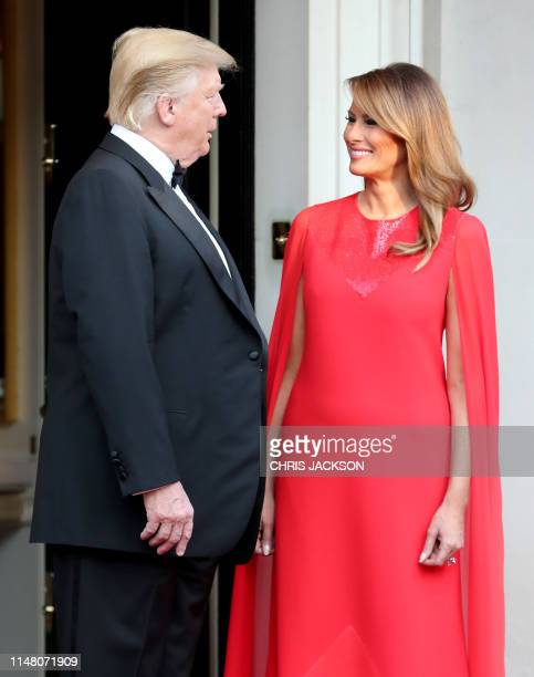 President Donald Trump and US First Lady Melania Trump wait to greet Britain's Prince Charles, Prince of Wales and his wife Britain's Camilla,...