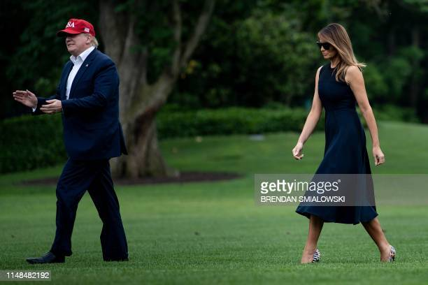 US President Donald Trump and US first lady Melania Trump walk from Marine One to the White House on June 7 in Washington DC