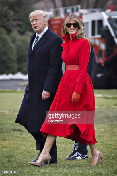 S President Donald Trump and US First Lady Melania Trump walk on the South Lawn of the White House to board Marine One in Washington DC US on Friday...