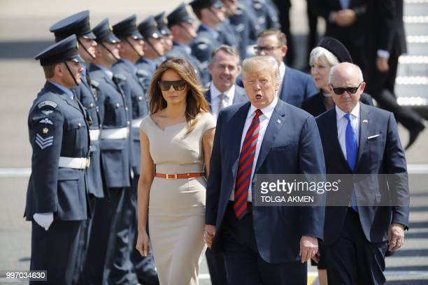 US President Donald Trump and US First Lady Melania Trump walk on the tarmac with US Ambassador to the United Kingdom Woody Johnson as they disembark...