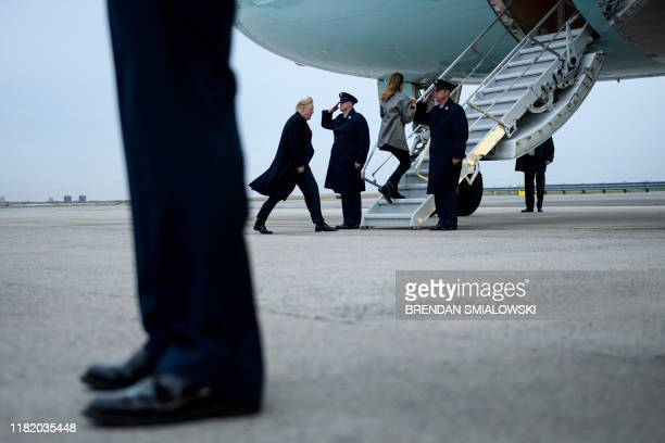 President Donald Trump and US First Lady Melania Trump walk to Air Force One at John F Kennedy International Airport November 12 in New York New York
