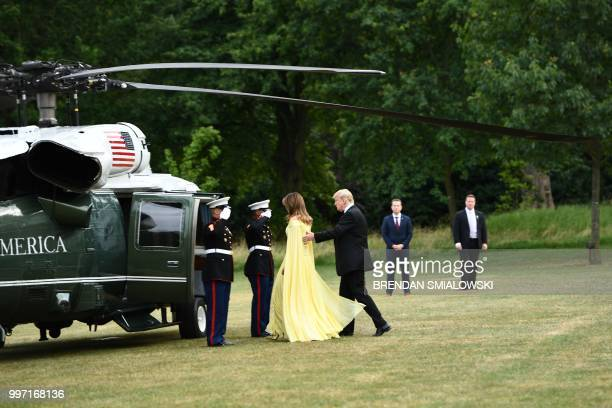 US President Donald Trump and US First Lady Melania Trump walk toward Marine One as they leave the US ambassador's residence Winfield House in London...