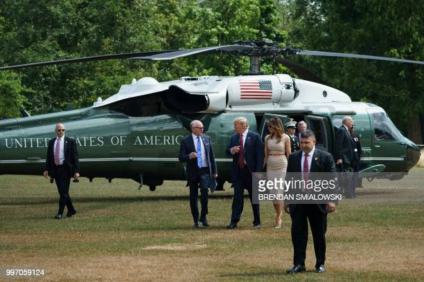 US President Donald Trump and US First Lady Melania Trump walk with US Ambassador to the United Kingdom Woody Johnson as they arrive at the US...