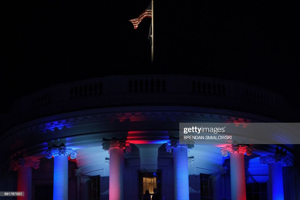 US President Donald Trump and US first lady Melania Trump watch fireworks from the Truman Balcony during a Independence Day celebration on the South Lawn of the White House July 4, 2018 in Washington, DC.