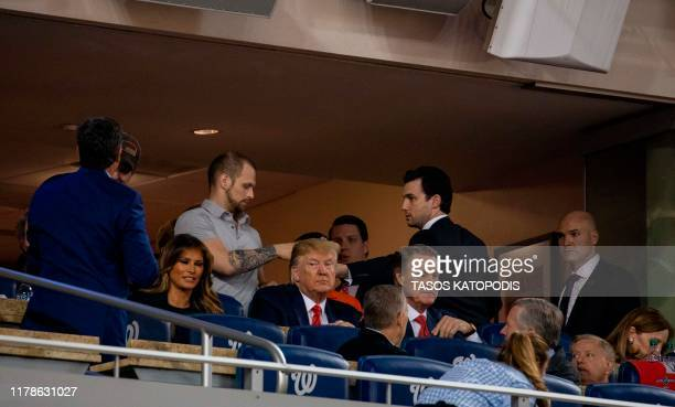 US President Donald Trump and US First Lady Melania Trump watch Game 5 of the World Series between the Washington Nationals and Houston Astros at...