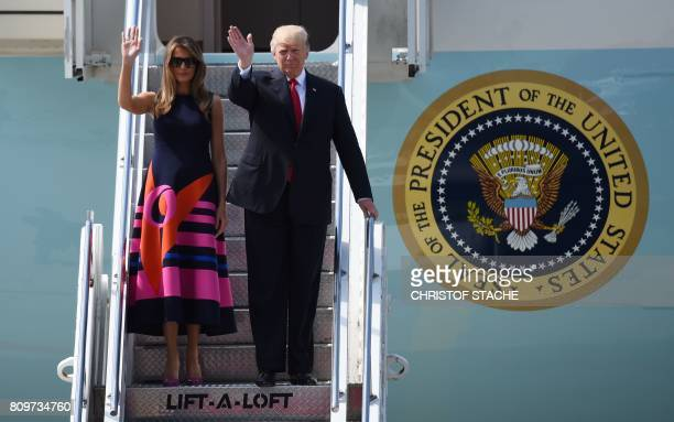 President Donald Trump and US First Lady Melania Trump wave as they step off Air Force One upon arrival at the airport in Hamburg northern Germany on...