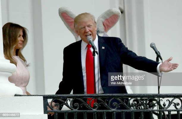 S President Donald Trump and US first lady Melania Trump welome guests to the White House during the 139th Easter Egg Roll on the South Lawn of the...
