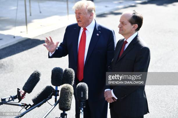 US President Donald Trump and US Labor Secretary Alexander Acosta speak to the media early July 12 2019 at the White House in Washington DC Trump is...