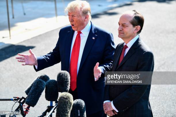 US President Donald Trump and US Labor Secretary Alexander Acosta address the media early July 12 2019 at the White House in Washington DC Acosta...