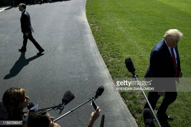 US President Donald Trump and US Labor Secretary Alexander Acosta walk off into different directions after a media address early July 12 2019 at the...