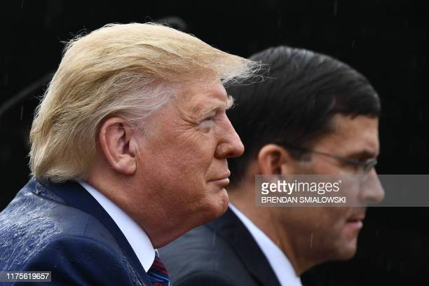 US President Donald Trump and US Secretary of Defense Mark Esper attend the Armed Forces Welcome Ceremony in honor of the Twentieth Chairman of the...