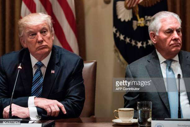 US President Donald Trump and US Secretary of State Rex Tillerson wait for a meeting with South Korea's President Moon Jaein and others in the...