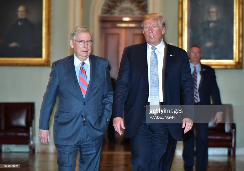 US President Donald Trump and US Senate Majority Leader Mitch McConnell make their way to a Senate Republican policy lunch at the US Capitol in Washington, DC on May 15, 2018.