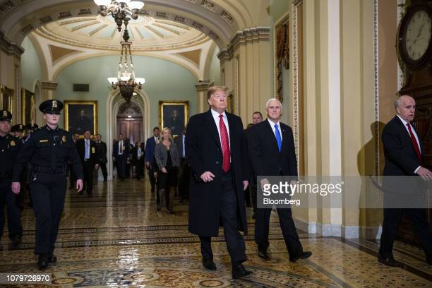 US President Donald Trump and US Vice President Mike Pence arrive to a Senate Republicans policy luncheon at the US Capitol in Washington DC US on...