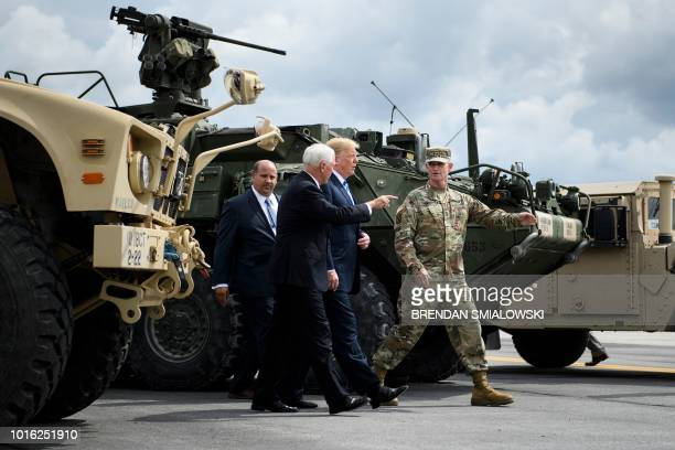 US President Donald Trump and US Vice President Mike Pence arrive to watch air assault exercises with Army Major General Walter Piatt at Fort Drum...