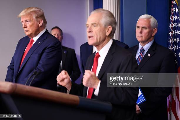 US President Donald Trump and US Vice President Mike Pence listen as White House Trade and Manufacturing Policy Director Peter Navarro speaks during...