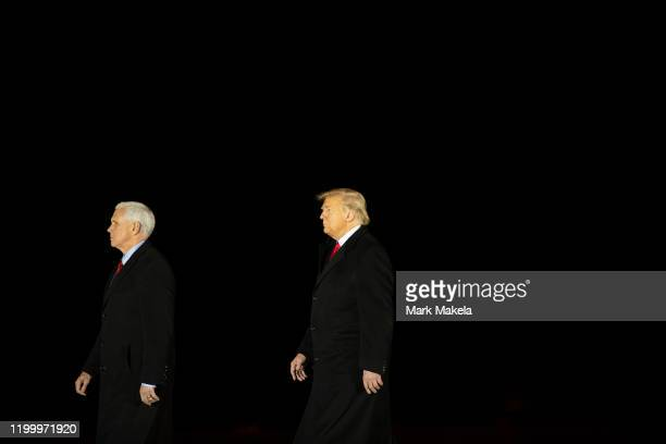 US President Donald Trump and Vice President Mike Pence arrive at a dignified transfer for fallen service members US Army Sgt 1st Class Javier J...