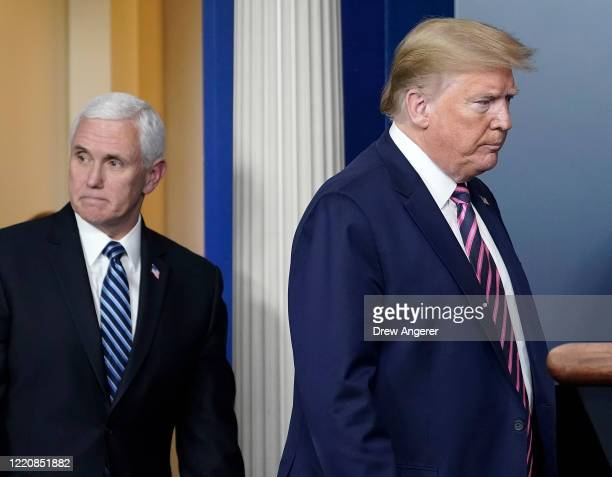 President Donald Trump and Vice President Mike Pence arrive at the daily coronavirus task force briefing at the White House on April 24, 2020 in...