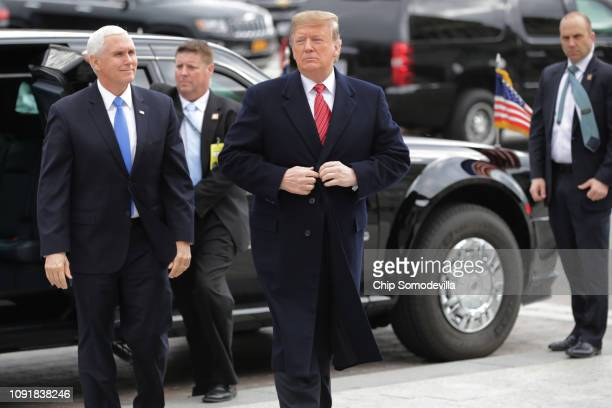 S President Donald Trump and Vice President Mike Pence arrive at the US Capitol to attend the weekly Republican Senate policy luncheon January 09...
